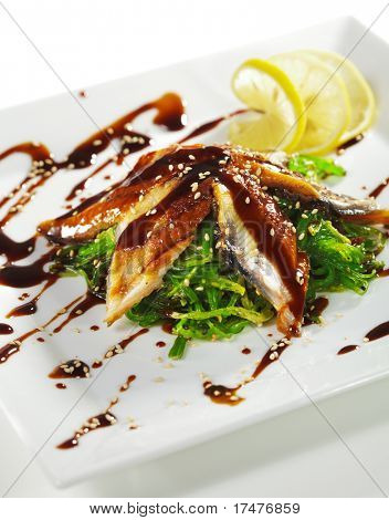 Japanese Cuisine - Chuka Seaweed and Unagi (smoked eel) Salad with Nuts Sauce. Topped with Eel Sauce and Sesame