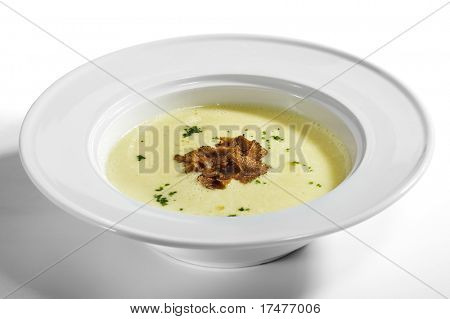 Potato Cream Soup garnished with Greens and Tartufo Bianco (white truffle)