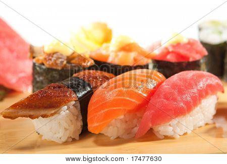 Japanese Cuisine - Sushi Set: Salmon, Conger and Tuna Sushi with Salad Leaf