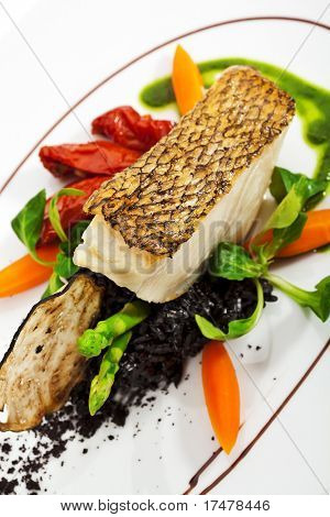 Chile Sea Bass (black sea bass) served with Black Risotto, Herbs and Vegetables