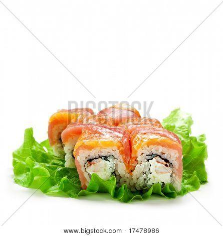 Salmon and Tuna Maki Sushi - Roll made of Cream Cheese and Shrimp (ebi) inside. Fresh Salmon and Tuna outside. Served pn Salad Leaf
