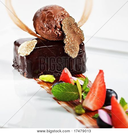 Ganache Dessert - Sweet mixture of Chocolate and Heavy Cream. Garnished with Tartufo Bianco (white truffle mushroom), Fresh Mint Leaf and Berries