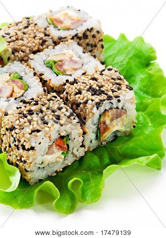 Chicken Maki Sushi - Roll made of Smoked Chicken Breast, Cheese, Fresh Tomato and Tamago (Japanese Omelet) inside. Sesame outside. Served on Salad Leaf