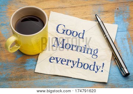 Good morning everybody - handwriting on a napkin with a cup of espresso coffee