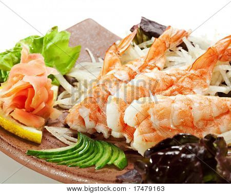 Shrimp Sashimi - Ebi (shrimp) on Daikon (White Radish). Garnished with Ginger, Wasabi, Seaweed, Cucumber, Salad Leaf and Lemon