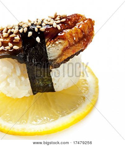 Japanese Cuisine -  Eel (unagi) Nigiri Sushi. Topped with Eel Sauce and Sesame. Served on Lemon Slice