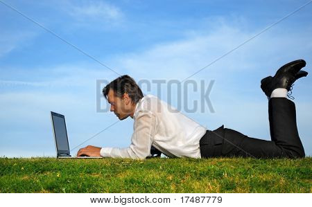 Businessman lie down and working