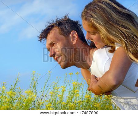 Young couple have fun on meadow