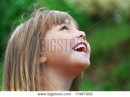 little girl singing and laughing in the garden