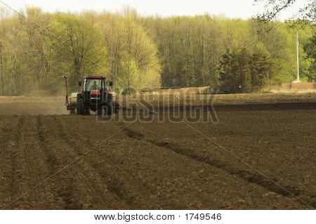 Farm Field And Tractor