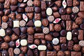 Assortment Of Fine Chocolate Candies. Top View poster