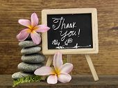 stack of pebbles and mini blackboard with text thank you poster