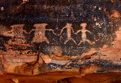 stock photo of atlatl  - Native American Petroglyphs in Red Sandstone From the Southwestern Desert - JPG