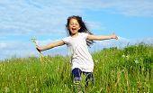image of little girls  - Little girl running on the meadow - JPG