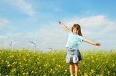 stock photo of dynamo  - Little girl in front of windmills - JPG