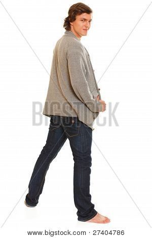 Full Length Portrait Of Young Man Turn Back