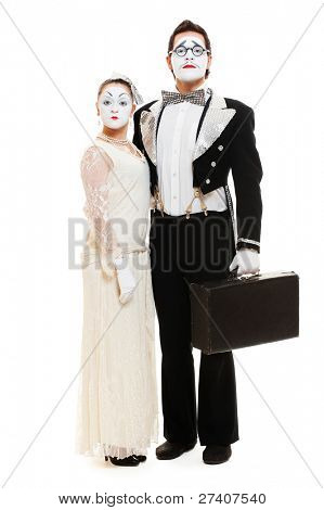 portrait of couple mimes over white background