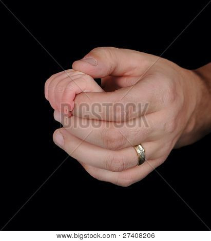 Father Holding Infant Baby's Tiny Hand. Isolated