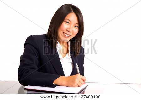 Asian Businesswoman Writing