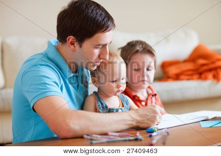 Father and his two kids drawing together