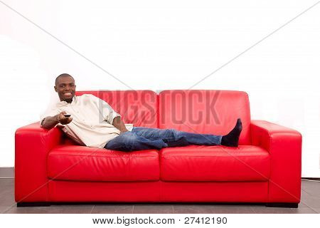 Man On The Sofa With Remote Control