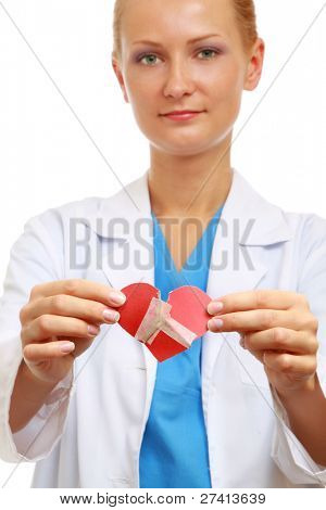 A female doctor holding wounded heart isolated on white background