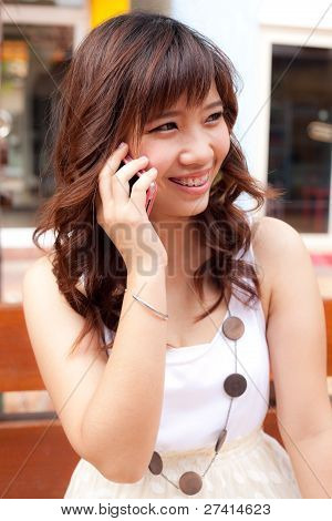 Woman Using The Phone.