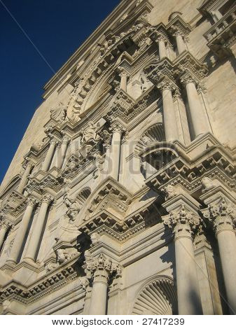 Spanish architecture. A fragment of an old building against the blue sky.