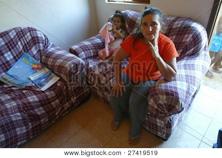 GONZAGA, BRAZIL - JULY 26:  Maria Otoni de Menezes sits in her home July 26, 2005 in Gonzaga, Brazil. Maria's son, Jean Charles de Menezes, 27-years-old, was killed by British undercover police.