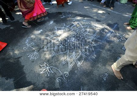 NEW YORK - AUGUST 30: Hindus walk around a religious symbol as they celebrate the birth of Ganesh, mythical god of new endeavors, at a Sri Ganesa Chaturthi event August 30, 2003 in Flushing, New York.