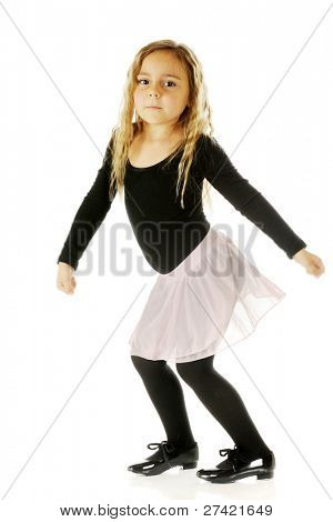 A pretty kindergartner tap dancing in her leotards, tutu and tap shoes.  On a white background.