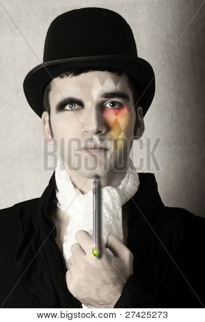 Fantastical stylized portrait of man in top hat and period clothing with surreal makeup