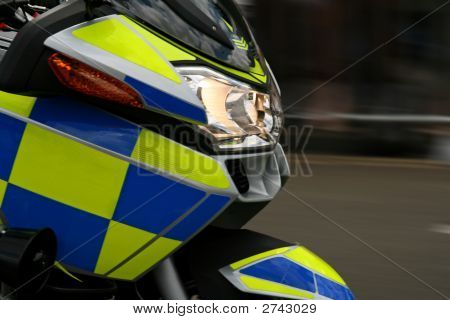 Speeding Police Motorbike With Blurred Background