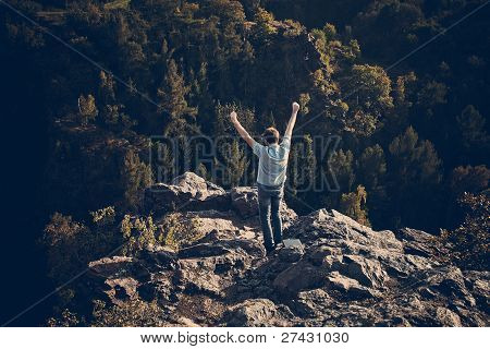 Young Man Standing On A Rock Slope