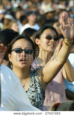 NEW YORK - JUNE 25: People pray as they attend the Greater New York Billy Graham Crusade on June 25, 2005 in Flushing, NY.