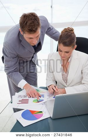 Business team analyzing survey results together