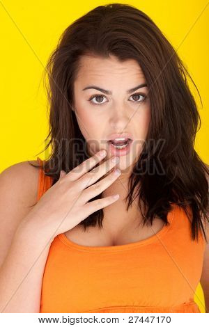 Woman Expressing Total Disbelief, woman with mussed hair amd her hand to her open mouth in wide eyed disbelief.