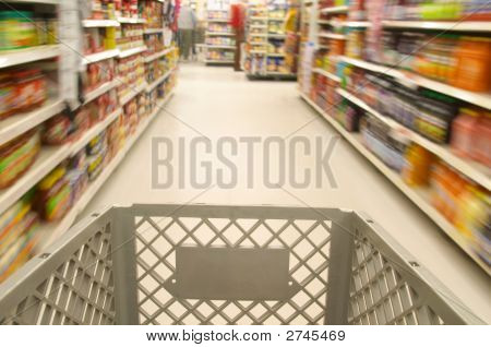 Shopping Cart Moving Through Market