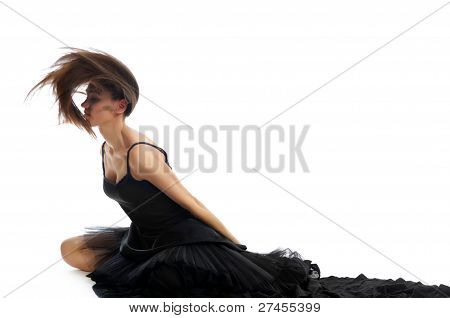 Dynamic Shot Of A Female Ballet Dancer Shaking Her Hair And Throwing It Back Isolated On White Backg