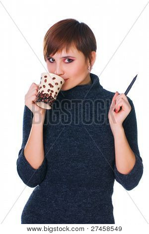 Woman with pencil and mug of coffee