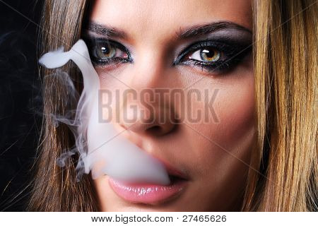 Woman smoking a cigarette macro shot