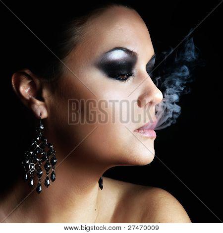 woman smokes in the dark