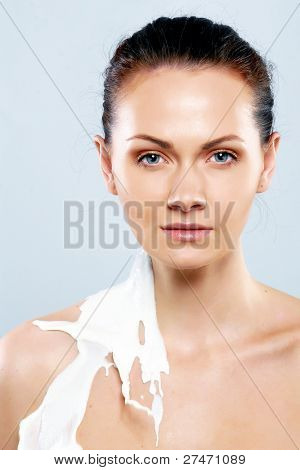 Photo of beautiful woman  in sprays milk