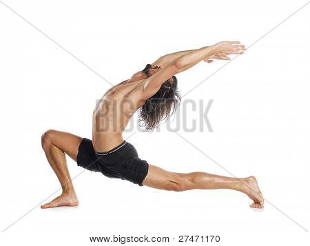 Man is making yoga isolated on white
