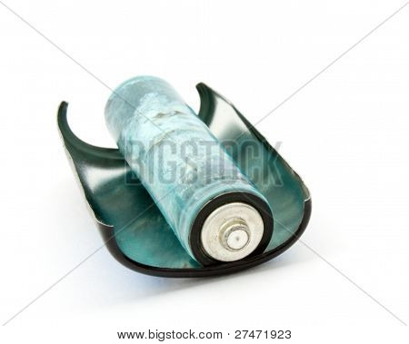 The Old Battery On A White Background.
