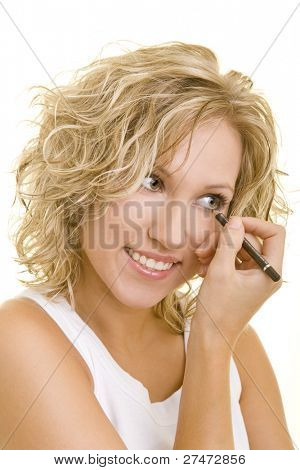 Blonde woman using eyeliner