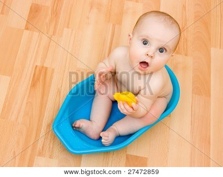 Surprised Kid Sitting In A Bathtub.