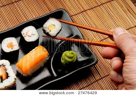 hand with sushi