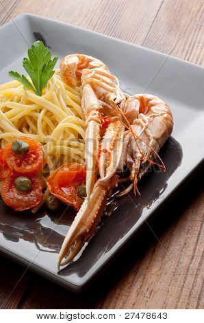 dish with scampi spaghetti and tomatoes