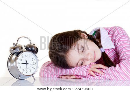 sleeping child and alarm clock